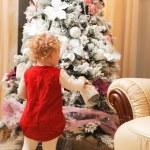 Little girl decorating christmas tree — Stock Photo