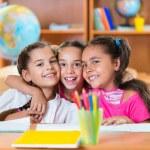 Portrait of smart schoolchildren in classroom — Stock Photo #31238147