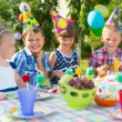 Group of kids having fun at birthday party — Stock Photo #31239371