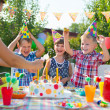 Group of kids having fun at birthday party — Stock Photo