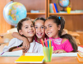 Portrait of smart schoolchildren in classroom — Stock Photo