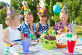 Group of kids having fun at birthday party — Стоковое фото