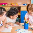 Group of cute little prescool kids drawing — Stock Photo #31241065