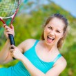 Sportswoman with racket at the tennis court — Stock Photo