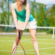 Beautiful female tennis player — Stock Photo