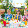 Group of adorable kids having fun at birthday party — Stock Photo