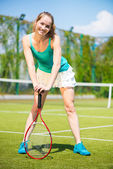 Beautiful female tennis player — Stock Photo