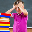 Adorable schoolboy with stack of books — Stock Photo #32132171