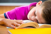 Tired schoolboy sleeping on book — Stock Photo
