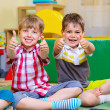 Excited children holding thumbs up — Foto Stock