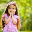 Portrait of hispanic girl in sunny park — Stock Photo #32821393