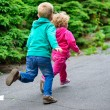 Stock Photo: Little brother and sister running