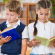 Stock Photo: Portrait of two diligent pupil with books