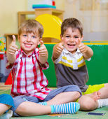 Excited children holding thumbs up — Stock Photo