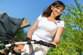 Beautiful young mother with stroller — Stock Photo