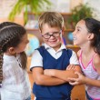 Three adorable schoolchildren having fun — Stock Photo