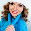 Portrait of beautiful young woman in blue knitted sweater — Stock Photo #32830991