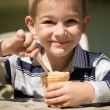 Smiling little boy eating ice-cream — Stock Photo