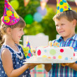 Cute children in love holding cake — Stock Photo