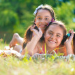 Two happy sisters having fun in the park — Stock Photo