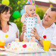 Happy family celebrating first birthday of baby — Stock Photo