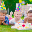 Three little kids celebrating birthday  — Stock Photo
