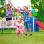 Three happy kids dancing — Stock Photo #33423029