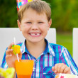 Happy boy having fun at birthday party — Stock Photo