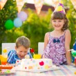 Birthday party with colorful cake at backyard — Stock Photo