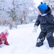 Two happy children playing snowball — Stock Photo #33982915