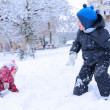 Two happy children playing snowball — Stock Photo