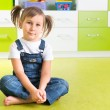 Girl sitting on floor — Stock Photo