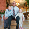 Happy grandfather with grandchildren — Stock Photo