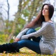 Beautiful girl at autumn park — Stock Photo