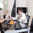 Young family celebrating at home — Stock Photo