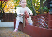 Cute little girl at playground — Stock Photo