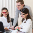 Three successful business people working at office — Stock Photo #36750915