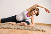 Young pregnant woman doing yoga execises — Stock Photo