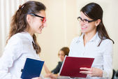 Two young girls at business meeting — Stock Photo