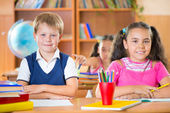 Happy pupils at school — Stock Photo