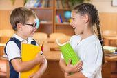 Happy pupils at school — Stock Photo