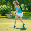 Portrait of young beautiful woman playing tennis — Stock Photo #41663367