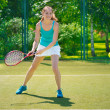 Portrait of young beautiful woman playing tennis — Stok fotoğraf #41663455