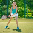Portrait of young beautiful woman playing tennis — Stock fotografie #41663455
