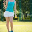 Portrait of pretty young tennis player — Stock Photo