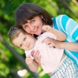 Stock Photo: Young mother and little son in park
