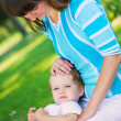 Young mother and little son in park — Stock Photo