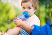 Cute little boy drinking water — Stock Photo