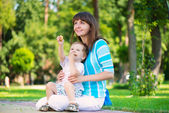 Happy family in sunny park — Stock Photo
