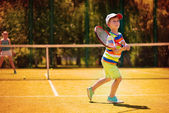 Little boy playing tennis — Stock Photo
